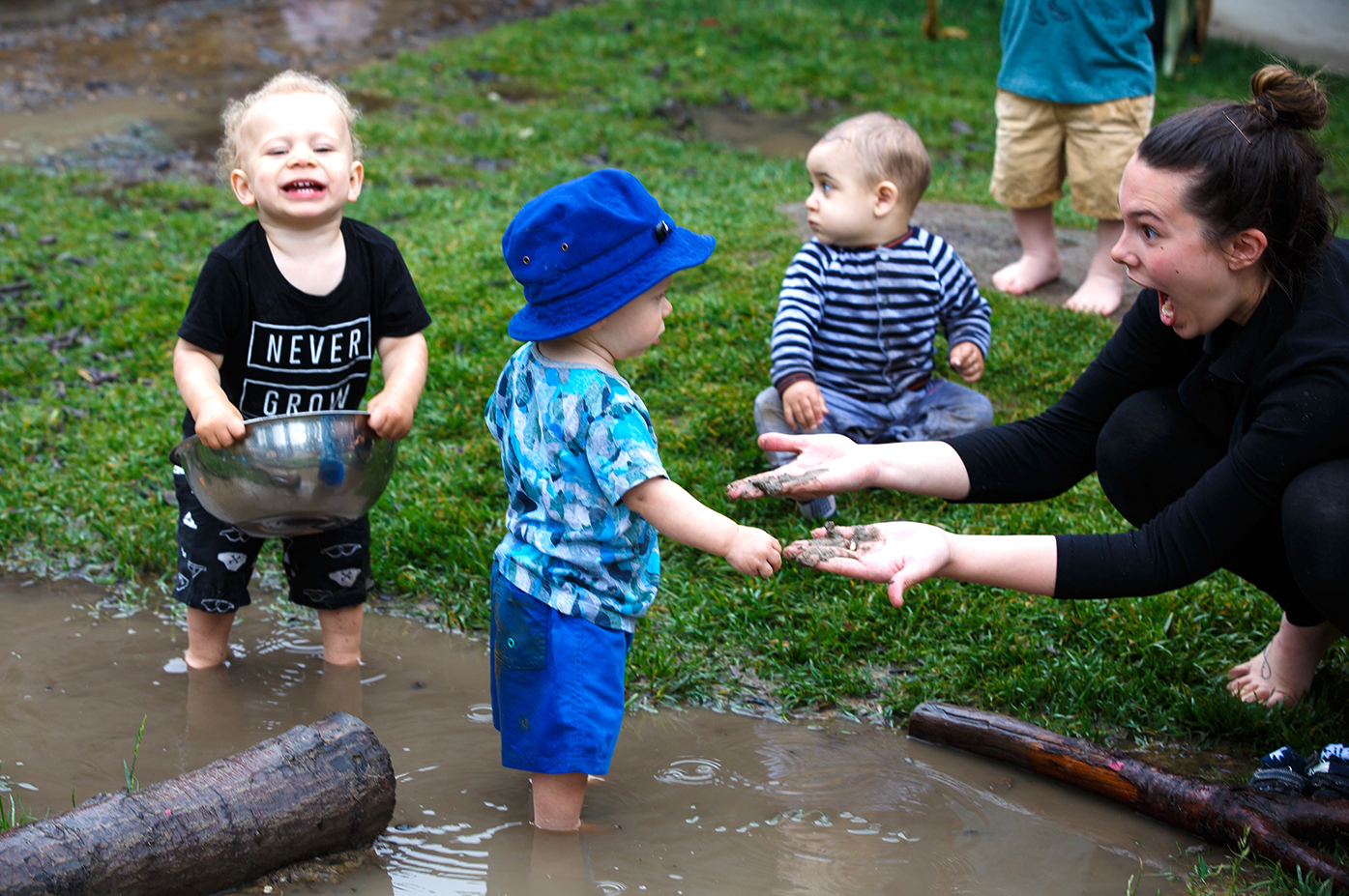 Babies, educator in mud