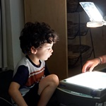 Young boy & light projector